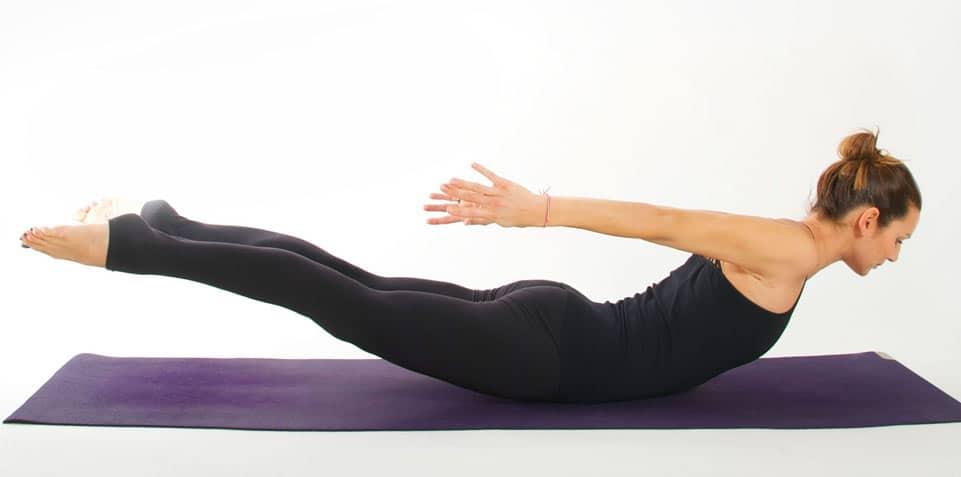 surf yoga locust pose