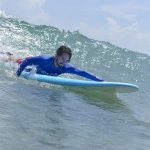 HOW TO PADDLE ON A SURFBOARD